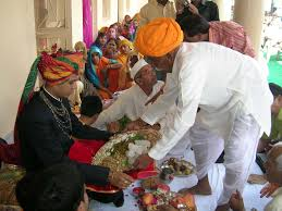 http://commons.wikimedia.org/wiki/File:Rajput_wedding_feast.jpg Licenced under creative commons.