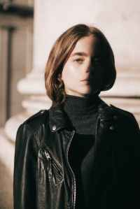 close up photo of woman wearing leather jacket